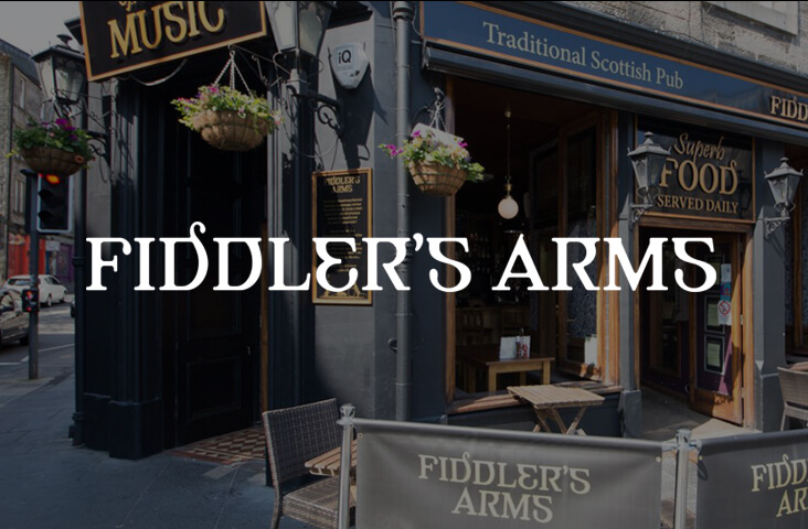 Exterior of the Fiddler's Arms Tavern Edinburgh with logo overlay - one of the best bars Edinburgh part of the Old Town Pub Co.