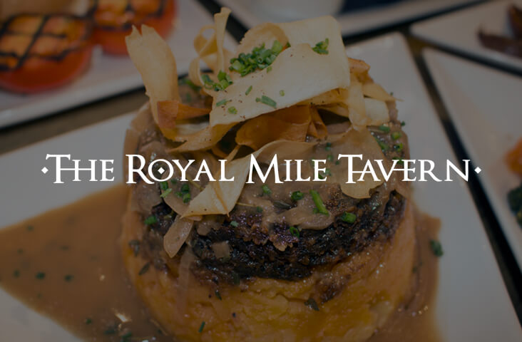 Image of haggis dish with The Royal Mile Tavern logo - one of the Old Town Pub Co. best restaurants Edinburgh