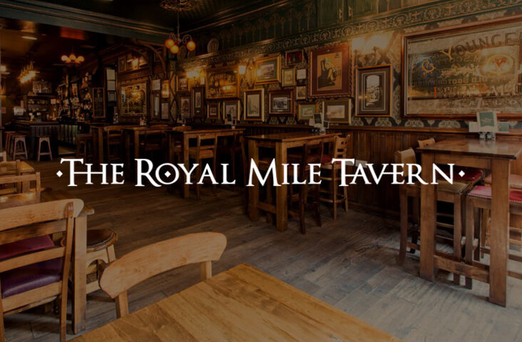 Interior of The Royal Mile Tavern Edinburgh with logo overlay - one of the best bars Edinburgh part of the Old Town Pub Co.