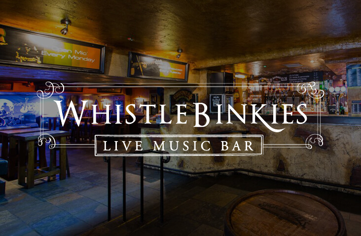 Interior of Whistle Binkies with logo overlay - one of the best bars Edinburgh part of the Old Town Pub Co.